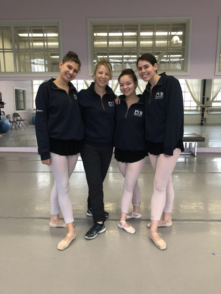 Photo of Grace Downey, friends, and instructor at Pioneer Valley Ballet